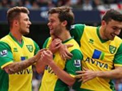 Manchester City 2 Norwich 3 - Premier League match report: Jonny Howson's winner gives Norwich a surprise victory at the Etihad Stadium