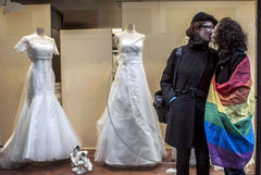 French president signs gay marriage bill into law