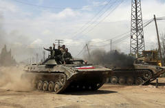 Syrian forces storm rebel bastion of Qusayr