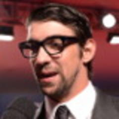 phelps throws cold water on comeback report